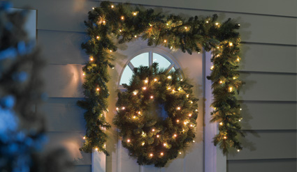 wreath door night lit